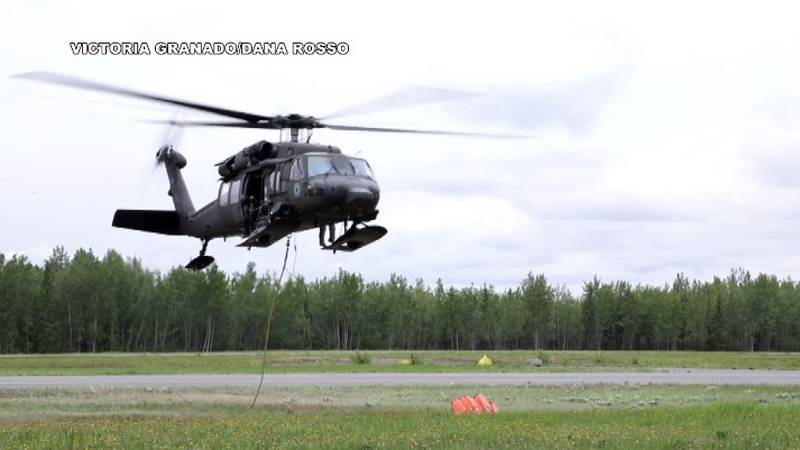 """AKNG UH-60 """"Black Hawk"""" trains to haul water to a wildfire on June 9, 2021."""