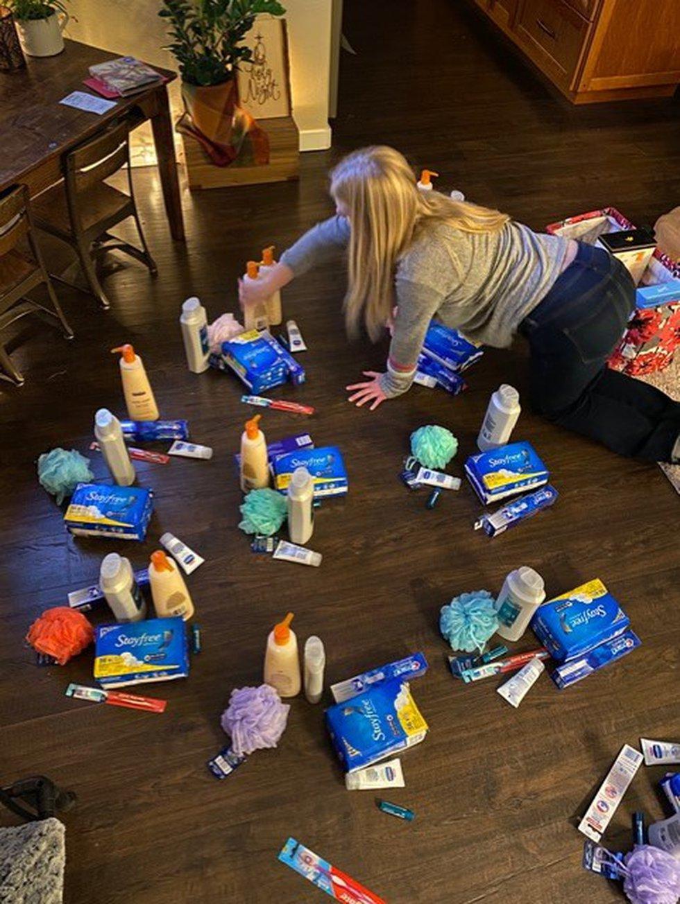 Assembling GracePacks to donate to women in need.
