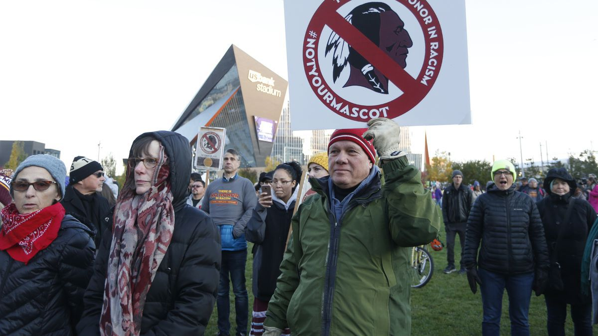 In this Oct. 24, 2019, file photo, Native American leaders protest against the Redskins team name outside U.S. Bank Stadium before an NFL football game between the Minnesota Vikings and the Washington Redskins in Minneapolis.(AP Photo/Bruce Kluckhohn, File)
