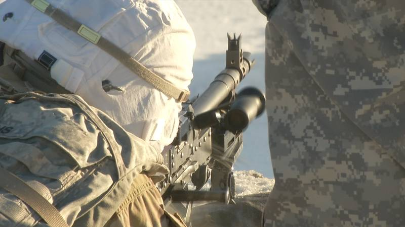 Spartan paratroopers train in Alaska's cold weather with M2-40 Bravo machine guns.