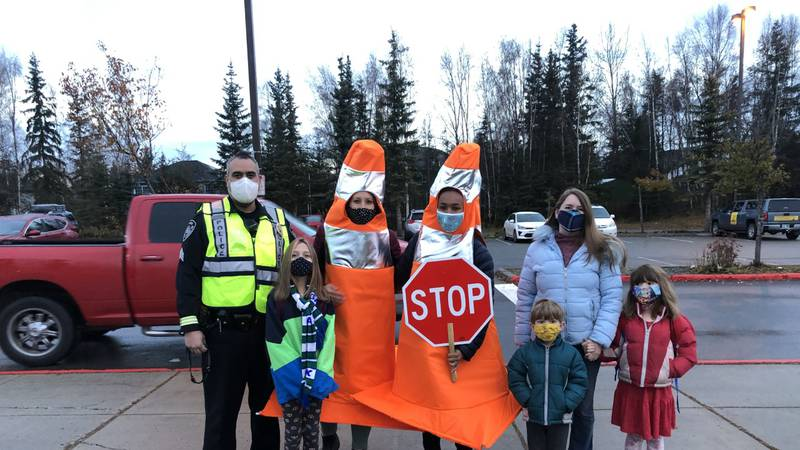 Teachers dress up as dancing traffic cones at Susitna Elementary to remind families to be safe...