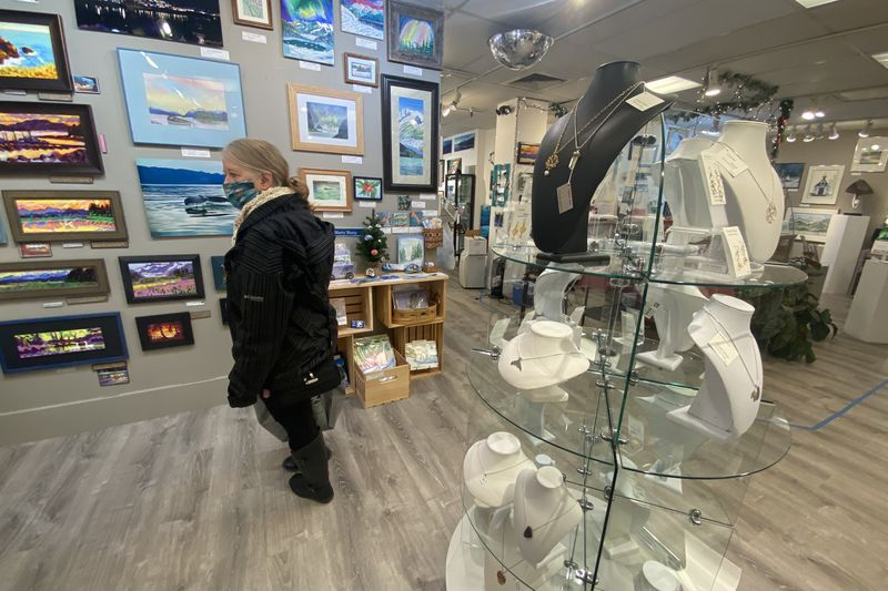 A shopper browses at the Juneau Artists Gallery.