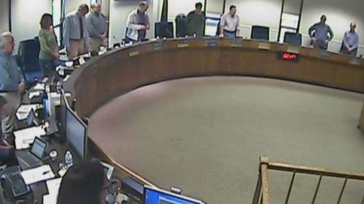 The Kenai Peninsula Borough Assembly stands for an invocation from a member of the Satanic...