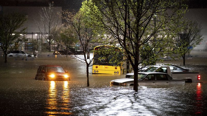 This photo shows cars stranded in a Walmart parking lot on Nolensville Pike in Nashville,...