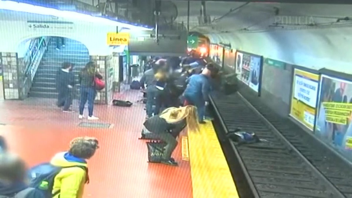 The train came to a stop just inches from the woman. (Source: Policia Nacional de Buenos Aires...