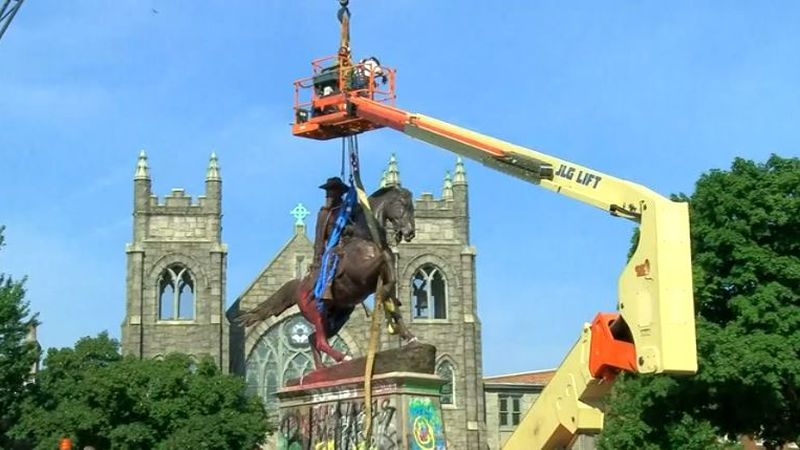 FILE - In this July 7, 2020, file photo, crews attach straps to the statue Confederate General...
