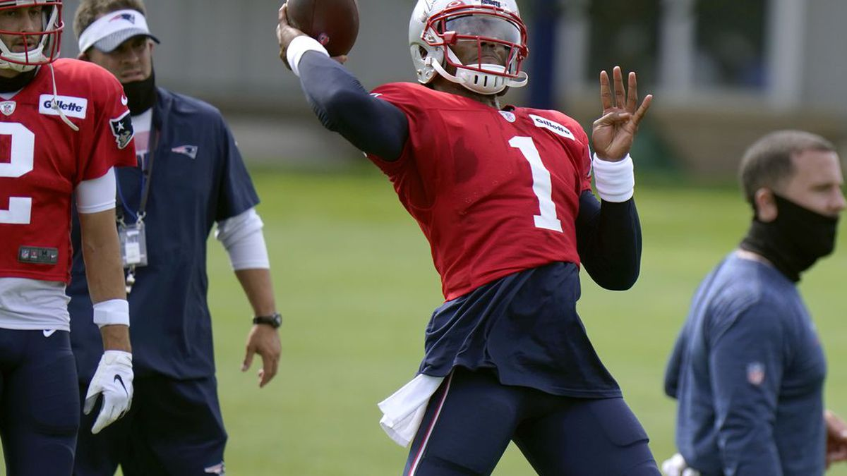 New England Patriots quarterback Cam Newton throws during an NFL football training camp...