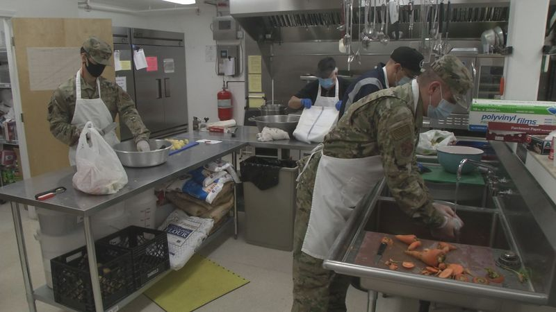 Members of the Air National Guard volunteer at the Five Loaves Two Fish Kitchen in Wasilla