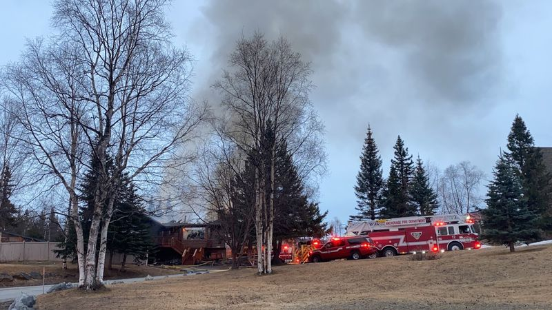 Firefighters respond to a house fire near Beacon Hill Drive in the Hillside neighborhood of...