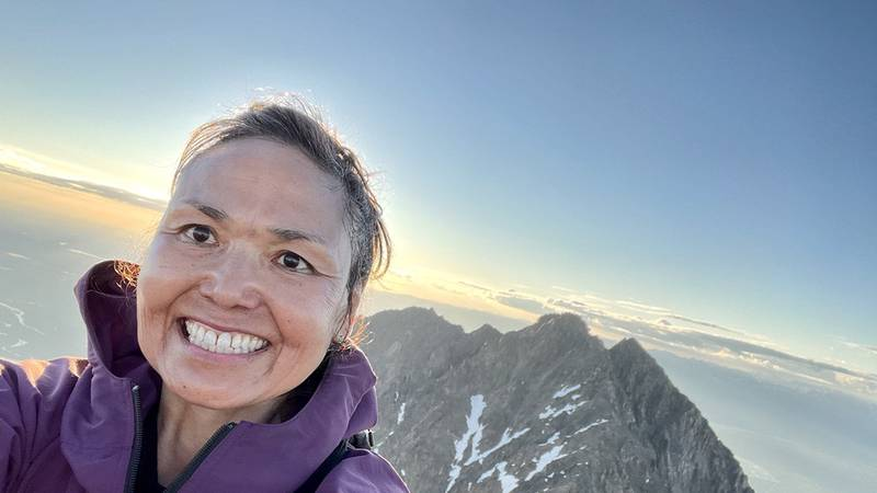 Palmer resident Fina Kiefer at the top of her hike to Pioneer Peak on Monday, June 14, 2021 in...