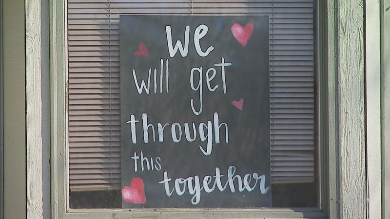 Inspirational signs appeared in windows across Anchorage as the coronavirus pandemic led to...