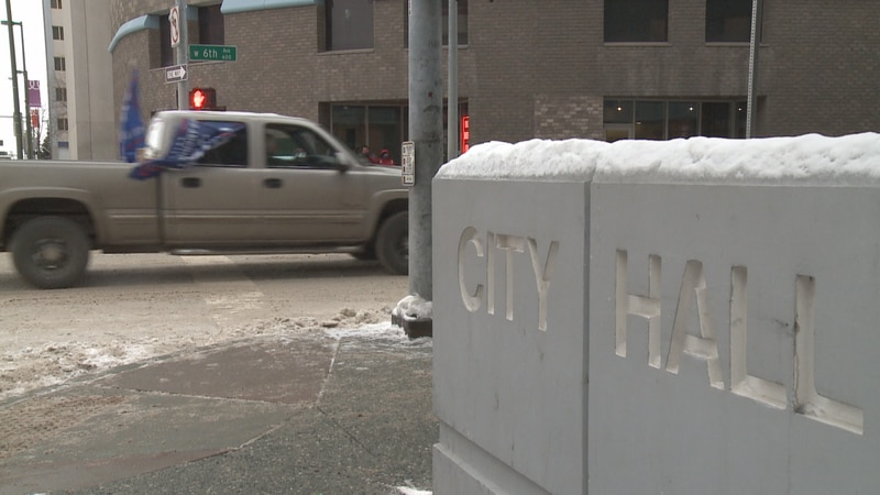 A convoy of cars and trucks circled Anchorage City Hall Monday to protest the latest emergency...
