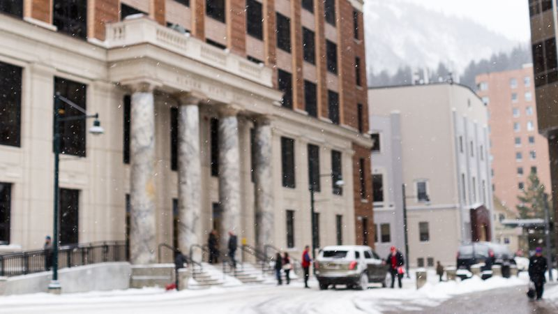 Snow falls in front of the Alaska Capitol in Downtown Juneau