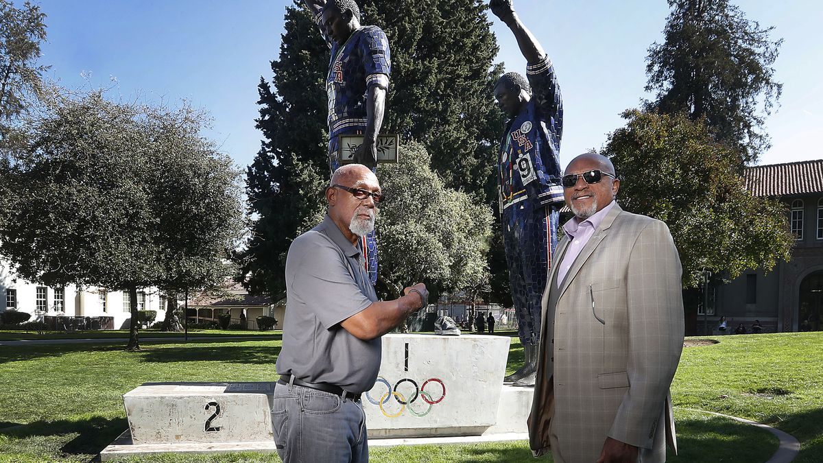 FILE - In this Oct. 17, 2018 file photo, John Carlos, left, and Tommie Smith pose for a photo...