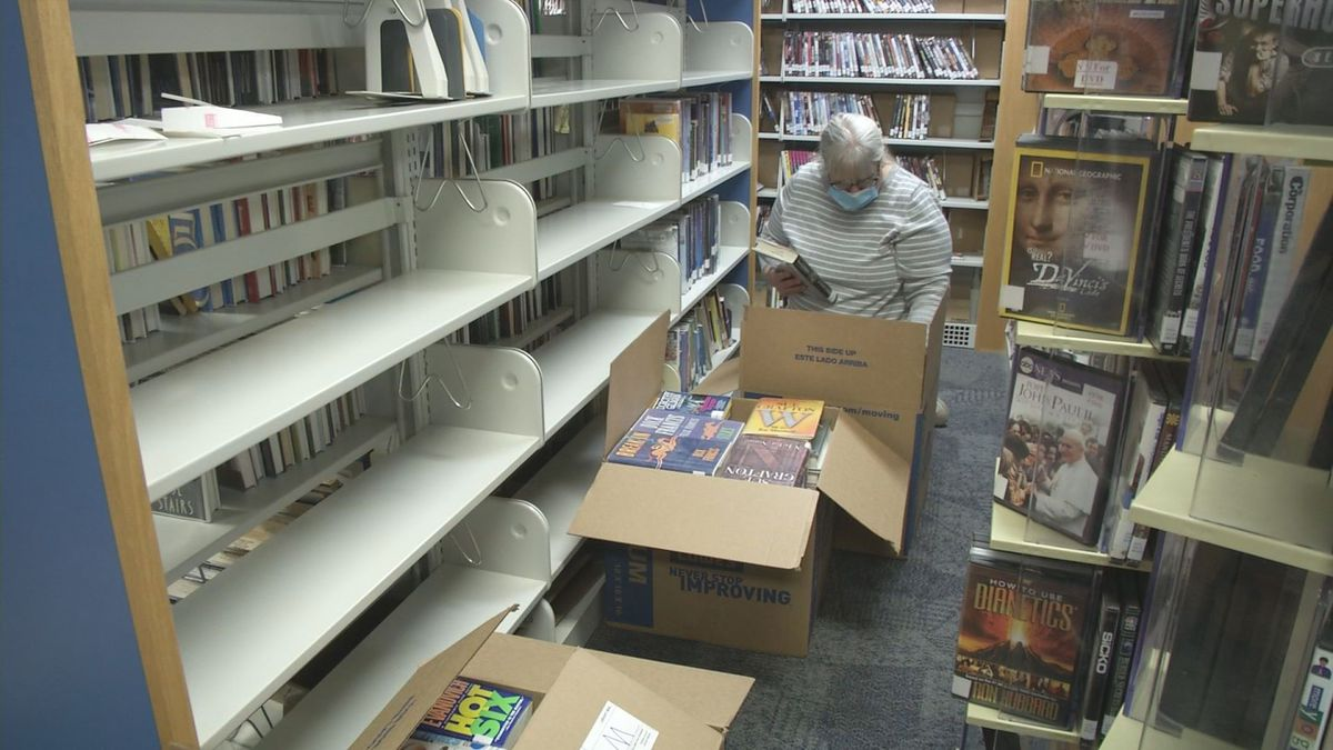Volunteers are packing up 35,000 books at the Willow Library in preparation for the building to be demolished.