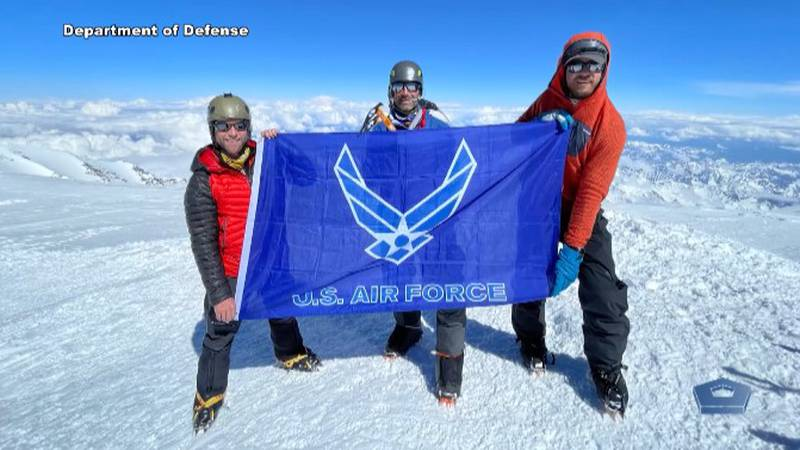 Lt. Col. Robb Marshall (left) and others on the summit of Denali on June 12, 2021.