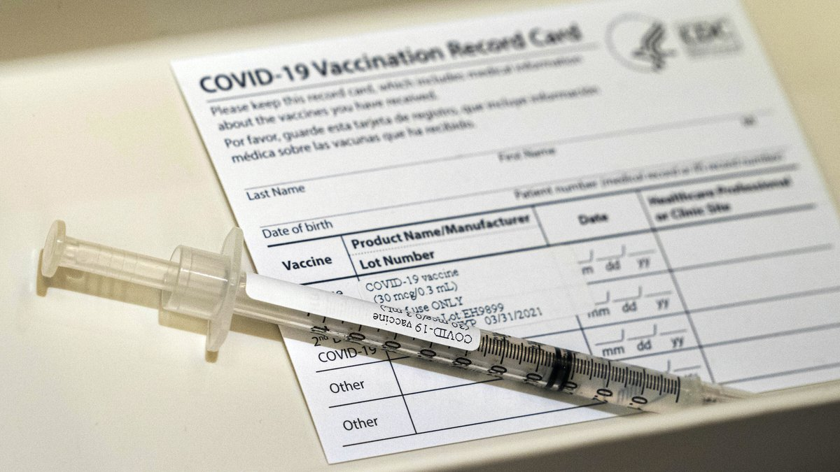 In this Wednesday, Dec. 16, 2020, file photo, a syringe containing a dose of the Pfizer...