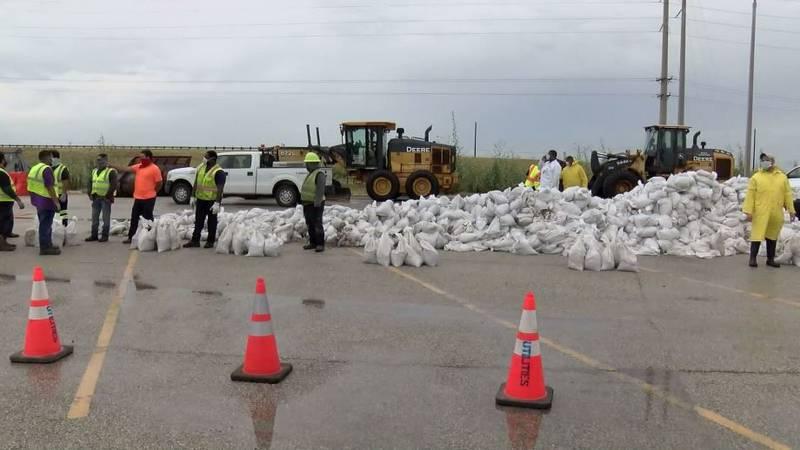 The City of Corpus Christi's Emergency Operations Center organized sandbag giveaways to help...