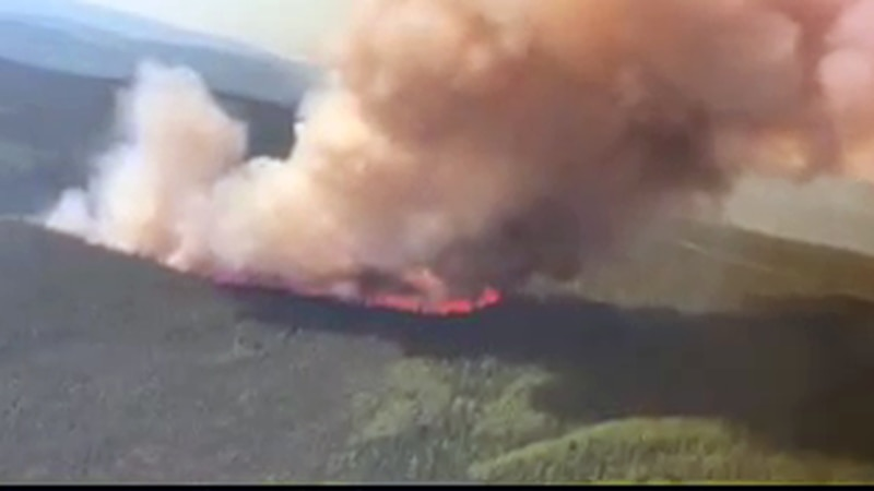 This screenshot taken from a video shows the Haystack fire burning about 20 miles from...