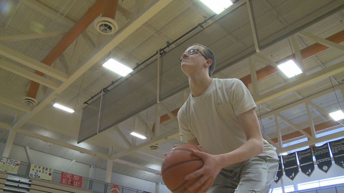 Dallin Lewis shooting baskets at the South Anchorage High School gym.