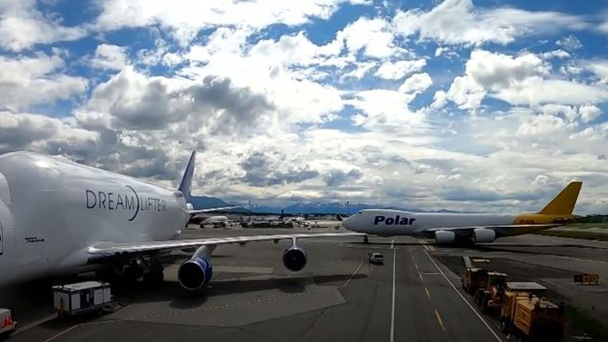 A Boeing Dreamlifter and Polar Air aircraft are seen at Ted Stevens Anchorage International Airport in May of 2020.