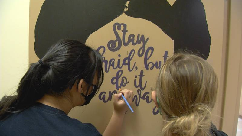 Service High School students use positive messages to counter vandalism.