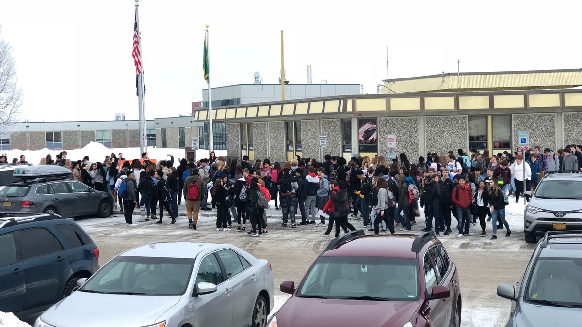 Service High School students walked out of class briefly Wednesday in honor of the students...
