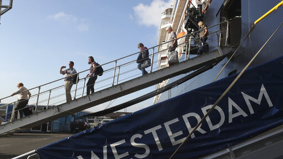 Passengers of the MS Westerdam, owned by Holland America Line  disembark from the MS...