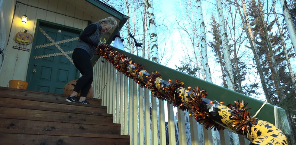 Shellhamer gives her safety chute a test run before trick or treaters get to give it a try.