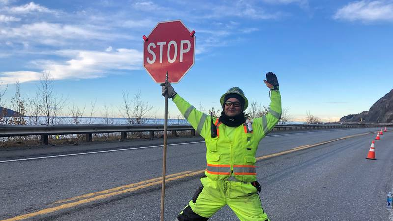 Flagger Patrick Deacon loves his job on the Seward Highway outside of Anchorage.
