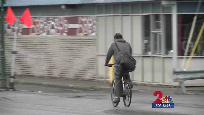 Bicyclist on sidewalk on Spenard Road