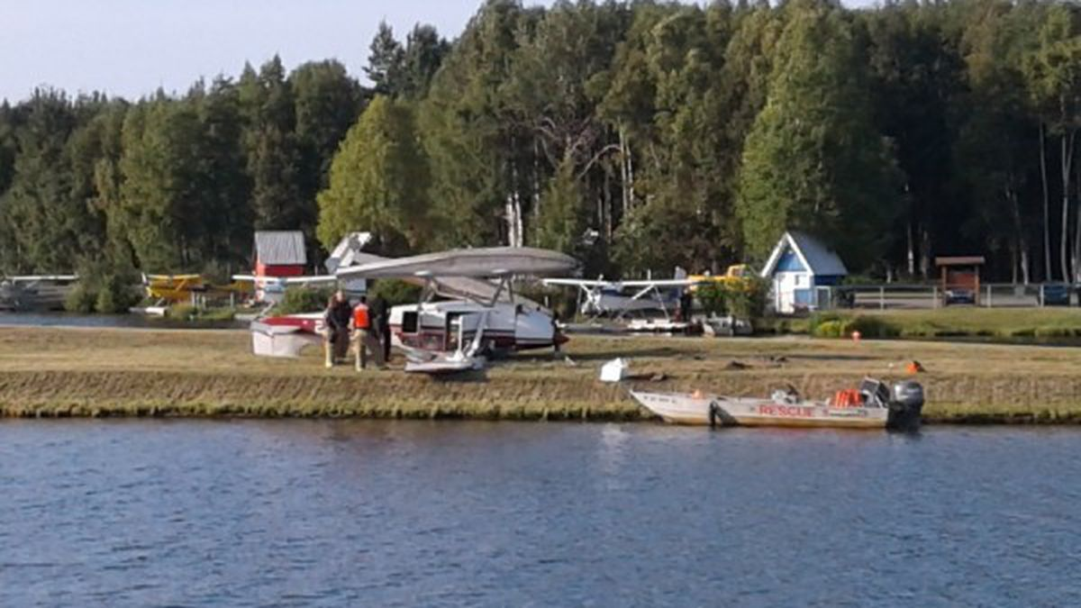 Emergency personnel respond to the crash on Gull Island, in the middle of Lake Hood, where a float plane crashed on Monday evening.