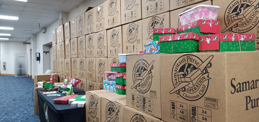"""""""Operation Christmas Child"""" shoe boxes being collected at Anchorage Baptist Temple."""