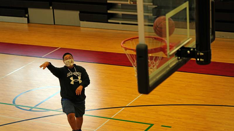 A Special Olympics Alaska athlete shoots some hoops during an event at the Jim Balamaci...