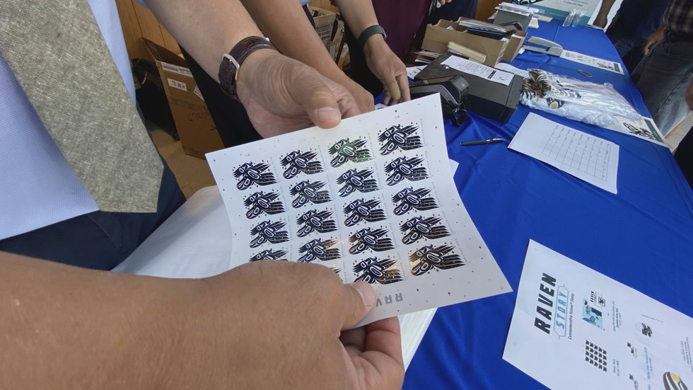 Sheets of the new Raven Story stamp are sold in Juneau. (07/30/2021).