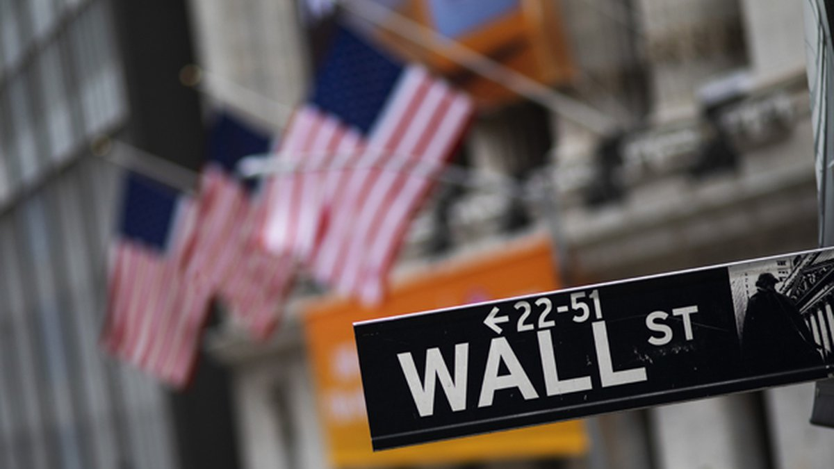 This Jan. 31, 2020 file photo shows a Wall Street sign in front of the New York Stock Exchange....