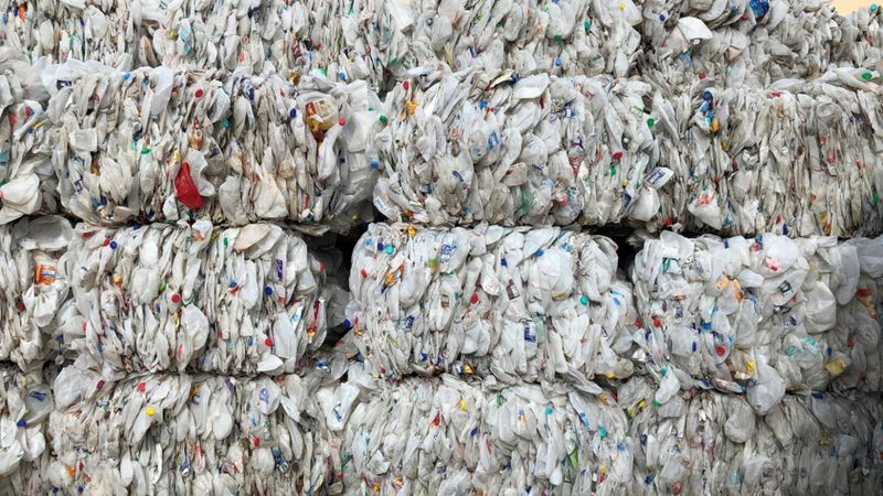 Bales of plastic recyclables from the Anchorage Recycling Center after being sent and sorted at...