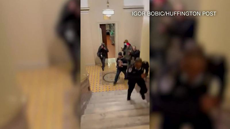 Officer Eugene Goodman is seen leading rioters away from the Senate chambers Jan. 6.