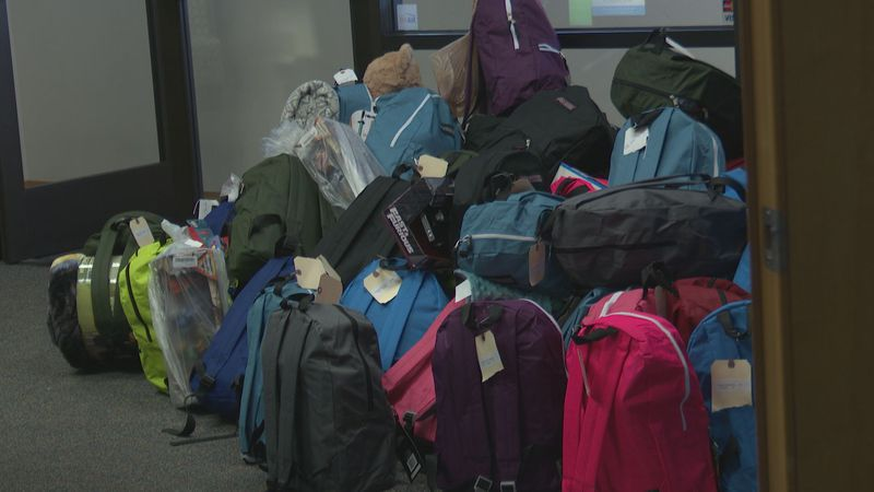 Backpacks stuffed with toys, clothes and treats wait to be distributed to Anchorage school...