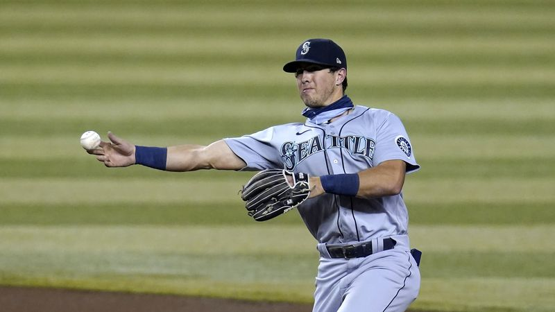 Seattle Mariners second baseman Dylan Moore throws the ball to first base during the first...