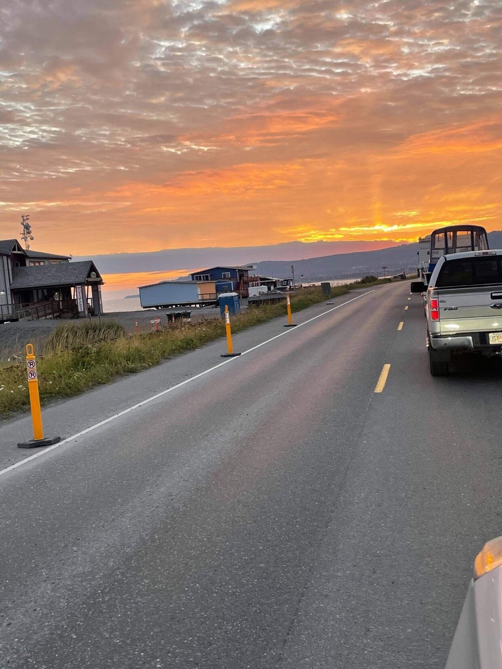 Cars evacuate off the Homer Spit after the community got a tsunami warning the evening of...