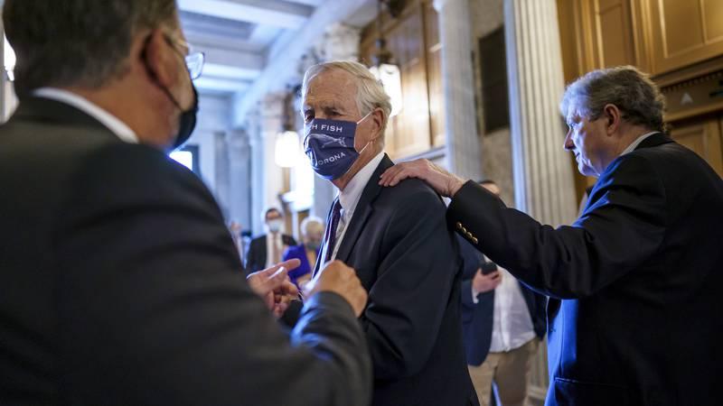 Sen. Angus King, I-Maine, center, speaks with Sen. Gary Peters, D-Mich., left, while Sen. John...