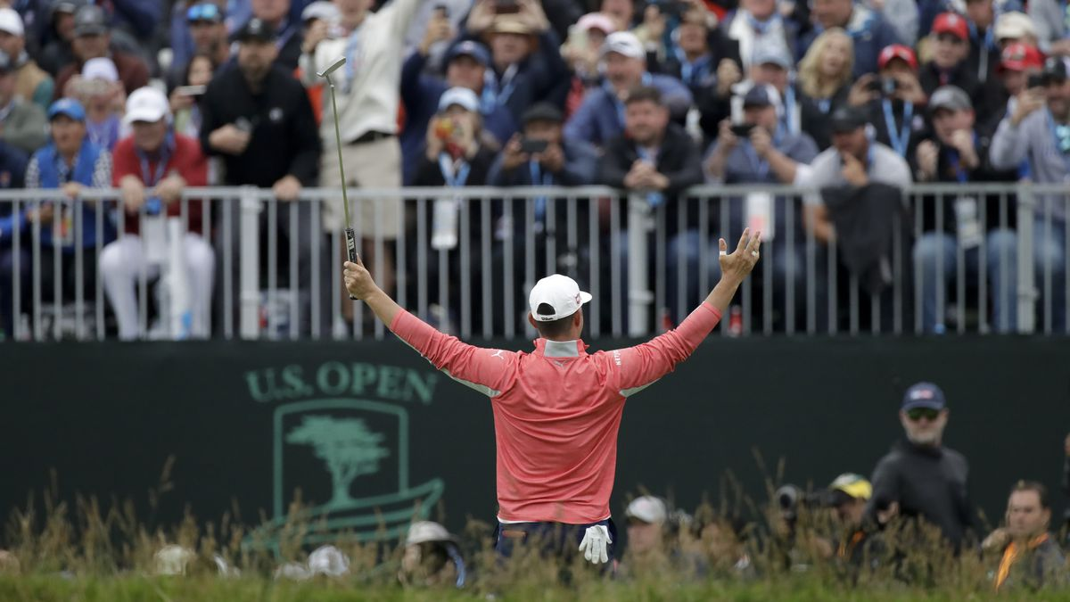In this June 16, 2019, file photo, Gary Woodland celebrates in front of fans after winning the U.S. Open golf tournament in Pebble Beach, Calif. The USGA announced Wednesday, July 29, 2020, that no fans will be allowed at Winged Foot in New York on Sept. 17-20 for the U.S Open, noting that the decision was based on health and safety concerns from the COVID-19 pandemic.