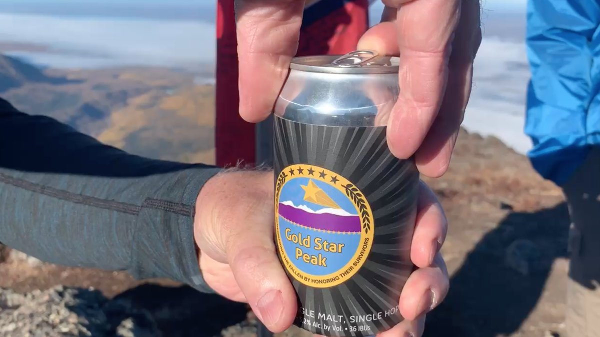 Ret. 1st Sgt. Kirk Alkire opens a can of Gold Star Belgian Ale atop Alaska's Gold Star Peak on...