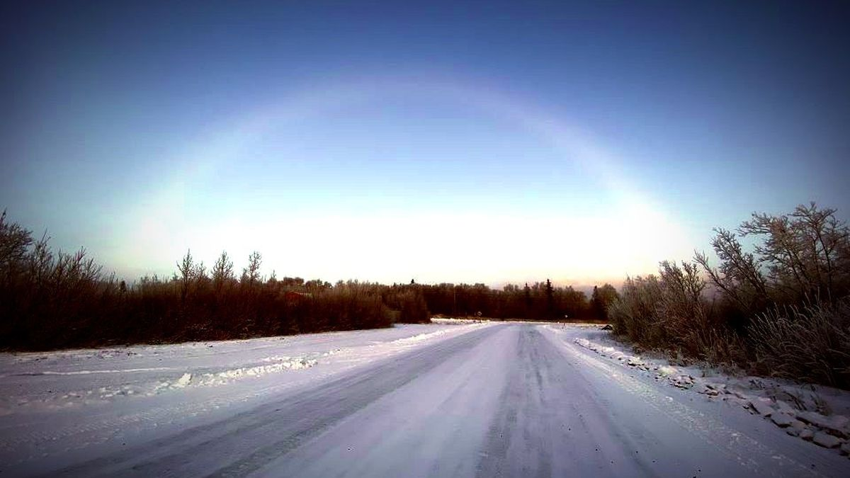 Fog bow or cloud bow appears over Kalskag in November. Lena Stewart says it was the first time she'd ever seen a white rainbow in her Kuskokwim River community. (Photo edited to better show cloud bow)