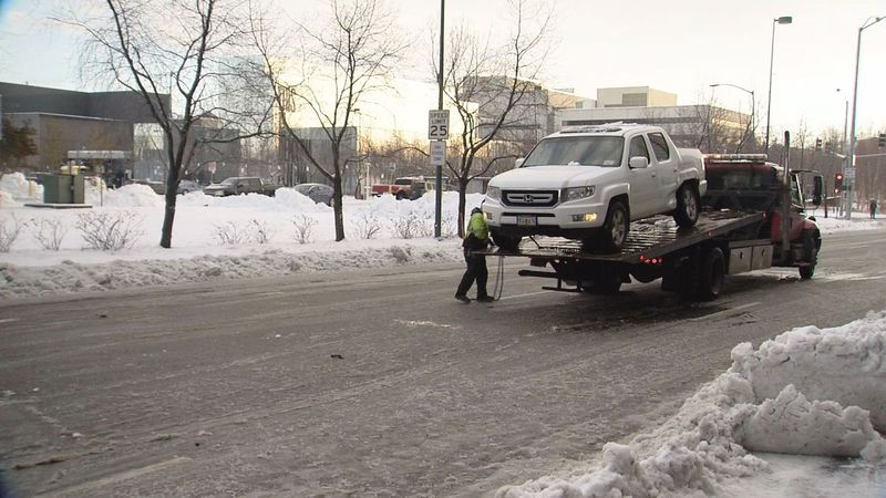 Anchorage police say dozens of collisions and vehicles in distress were reported after a snowy,...