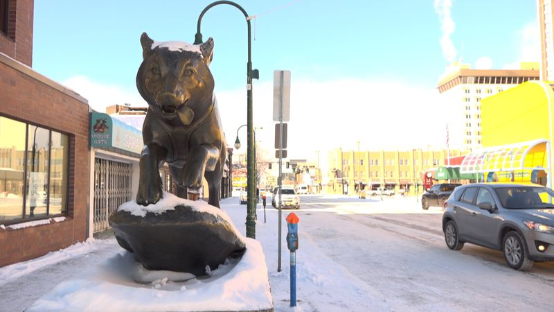 The sled dog statue in front of the Fur Rendezvous on 4th ave. in Anchorage. With the...