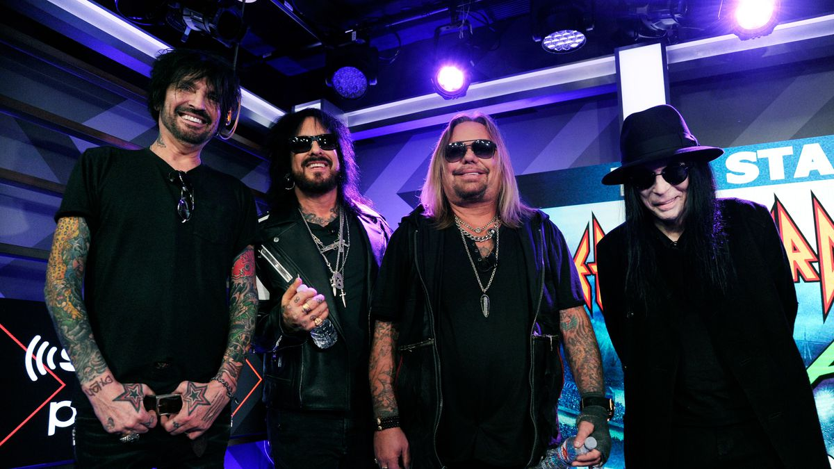 Tommy Lee, from left, Nikki Sixx, Vince Neil and Mick Mars of Motley Crue pose following a news conference to announce The Stadium Tour 2020.