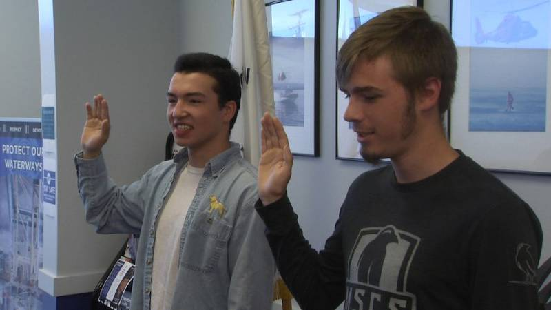 Bethel's Matthew Kapsner, left, and Gabriel West, right, of Big Lake, are sworn into the U.S....