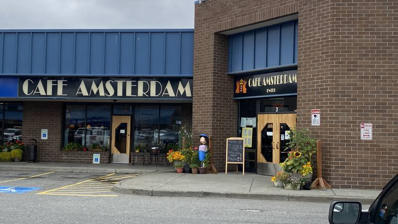 Cafe Amsterdam continues to require employees and customers to wear a mask as COVID cases...